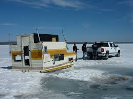 Ice Fishing   Alberta Environment and ParksPhoto of crews removing a converted camper