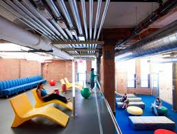 a lounge and workspace in googles chelsea market office where employees can get together for a best google office