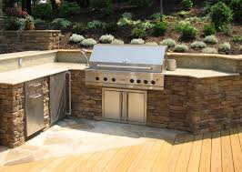 made of natural stone using granite countertop built in steel barbeque grill placed on light brown amusing cool diy patio