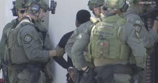 <b>City</b> Heights <b>SWAT</b> standoff ends with arrests of 7 robbery suspects ...