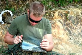 u s department of defense photo essay a u s marine reviews overlays to a map while conducting combat exercises at the jungle warfare