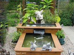 diy patio pond:  tier wood framed raised pond with water feature