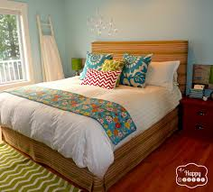 bedroom master ideas budget: master bedroom with diy upholstered headboard and matching bedskirt at thehappyhousie