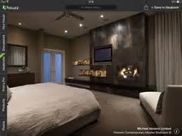 recessed lighting bedroom with feature wall tv and fireplace bedroom pinterest wall tv bedroom recessed lighting
