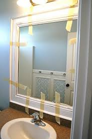 bathroom mirror scratch removal malibu ca youtube: frame guest bath mirror and put up decorative wainscoting on blank wall all we did to adhere it to the mirror was slap some liquid nails on the back and