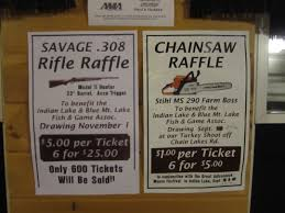 2011 i could cry but i don t have time correct me if i am wrong but i don t remember ever seen signs hanging side by side for both a rifle and chainsaw raffles why is it that the only thing i