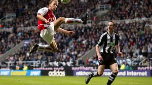 a beautiful mind dennis bergkamp s perfect moment premier arsenal s dennis bergkamp l jumps to control the ball as newcastle united s andy o