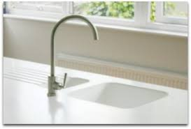 corian kitchen top:  corian sink molded into white countertops drain board  cmprs