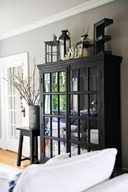 ideas china hutch decor pinterest: thoughts on decorating the top of an armoire