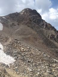 travel essay sometimes the hardest part and the best part are the across the switchback we reached the base of the far peak and the trail disintegrated the peak to our right and a steeply angled snowfield to our