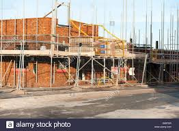 building site for a new housing estate uk scaffolding around a building site for a new housing estate uk scaffolding around a new house build