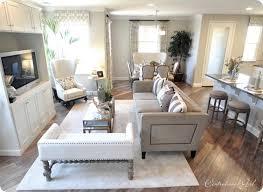model living rooms: neutral living room floors nailhead tv cabinet love model townhouse