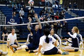 u s department of defense photo essay retired navy seaman steven davis center sets a ball for the navy s warrior games