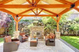 working creating patio: large gazebo patio with brick fireplace situated at the end