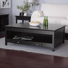 elegant square black mahogany dining table: good looking coffee table with storage and white sofabed with wood laminate floor