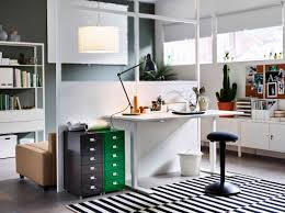 modest white wooden office desk with white polished metal leg equipped black fabric stool on black striped rug as well as grey green high gloss lacquer black gloss rectangle home office