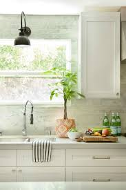 subway tile with light above kitchen sink above kitchen sink lighting
