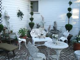 working creating patio: ive been working on creating a patio with a formal french garden ambiance i started with iron furniture and painted it off white