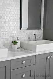 dog faces ceramic bathroom accessories shabby chic: formica calacatta marble laminate countertop hexagon mosaic marble backsplash and chelse gray vanity in ensuite bathroom with raised sinks by kylie m