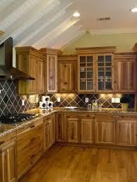 euro week full kitchen: kitchen decor ideas rustic kitchen hickory cabinets wood floor tile backsplash i like color of counters