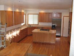 oak kitchen cabinets wood floors oak cabinets natural oak flooring x tile countertops and pretty dull