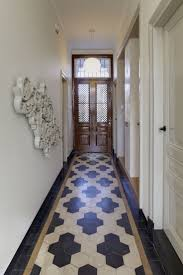 kitchen floor tiles small space: love the hex tile pattern in this hallway huize vreeburg in the netherlands