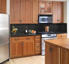 kitchen cabinets home office transitional:   kitchen colors with oak cabinets and black countertops
