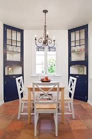 corner cabinets dining room: dark blue corner cabis in a white kitchen cabi dining