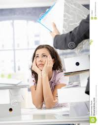 young office worker having too much work royalty stock young office worker having too much work