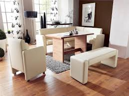 black and white dining table set: modern corner dining table set idea with white sofa banquette anc bench and wooden table and