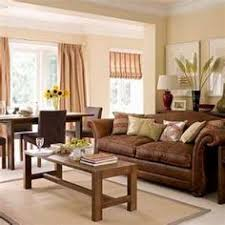 brown couch white trim natural color accents brown furniture living room ideas