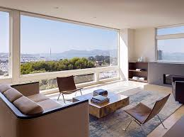 luxury minimalist living room with leather furnishing and awesome coffee table with large glass window and amazing bay view awesome large living room
