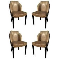 two pairs of period art deco ebonized side chairs from a unique collection of antique art deco dining chairs