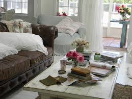 Living Room Brown Sofa Use Pale Pink Flowers With Small Vase On Table Get Two White