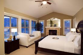 big master bedrooms couch bedroom fireplace: this master bedroom is dominated by the bed in a gorgeous cherry wood bed frame