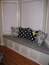 stunning white and grey theme bay window seating with white color scheme window curtains also bay window seat cushion