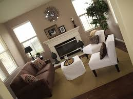 living room love this paint coloreither a light brown or grey for the wallswhite trim brown couches white diy fireplace white coffee table brown furniture living room ideas