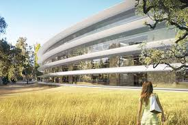 steve jobs from apple has recently introduced the new campus and office projects a circular design with an infrastructure of glass and a park inside apple new office design