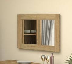 this large wall mirror makes a wonderful statement piece in a living room or dining room it can be hung landscape or portrait giving you flexibility with baumhaus mobel solid oak medium wall mirror
