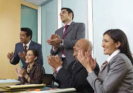 successful mentors have these 15 characteristics business people applauding at meeting to welcome a new employee