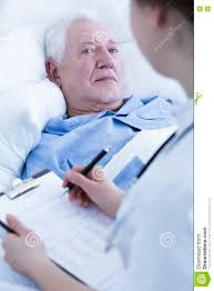 nurse interviewing elderly patient stock photo image  nurse interviewing elderly patient