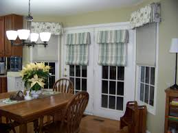 patio doors with blinds between the glass: glass door with white wooden frame combined with white and tosca stripped blind placed on the