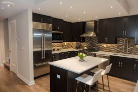 countertops dark wood kitchen islands table: of apartment kitchen with black finish l shape kitchen cabinets and elegant white marble countertop kitchen island table by two plastic chairs ideas