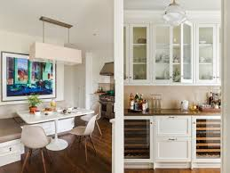 white kitchen nook windows eames chair left a greg girard photograph sits above the kitchen breakfast nook cl