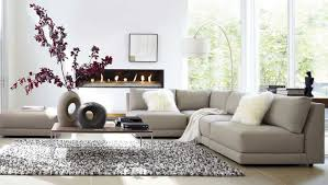 living room sectional with beige sofa and beige ceramic tile flooring combined with white wall paint color complete with chic standing lamp beige sectional living room