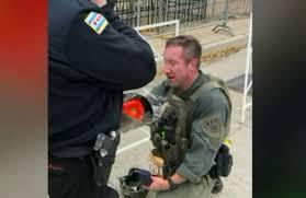 Chicago <b>cop</b> running race in full SWAT gear saves <b>woman's</b> life ...