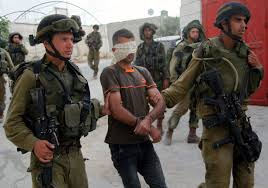hebron sends more troops to west bank as search for teens i iers arresting a palestinian young man in the area around the west bank city of