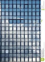 sky reflection in windows of an office building building an office