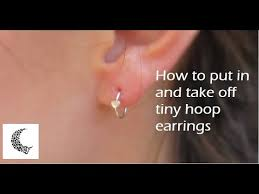 How to put in and take out tiny hoop earrings and nose rings ...