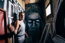 photo essay street art in barcelona nu journalism abroad 7 tort stands in front of a portrait in his studio that was inspired by a